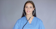Smiling friendly nurse or doctor with stethoscope Stock Footage