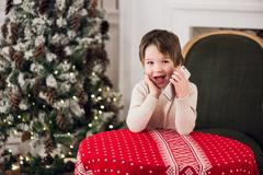 Little happy boy at home using smart phone Stock Photos