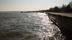 The frames of the solar sea. City embankment. Sea water. Russian Crimea. Stock Footage
