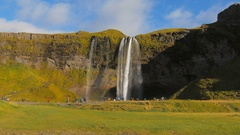Long shot of famous icelandic waterfall Seljalandsfoss in sunny autumn day Stock Footage