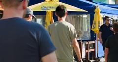 People at the restaurant on promenade landmark in Venice Beach in Los Angeles 4K Stock Footage