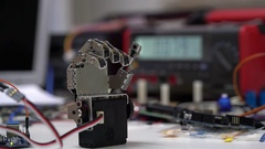 Debugging artificial palm robotic palm. Robot arm Stock Footage