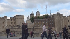 Tourists Walking Visiting Tower of London Museum Area Close Thames River. Stock Footage