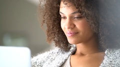Beautiful mixed-race woman shopping on internet Stock Footage
