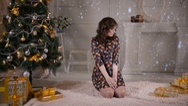 Beautiful girl, young woman posing near Christmas tree. New year celebration Stock Footage