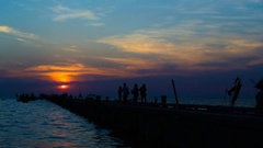 Sunset at sea with silhouette of jetty, 4K Time lapse Stock Footage