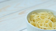Cooking Italian pasta served in white bowl Stock Footage