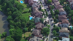 Aerial - Houses Backing on River Stock Footage