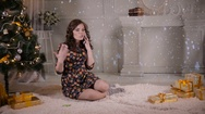 Attractive young girl speaks by mobile phone near the Christmas tree. Christmas Stock Footage