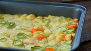 Roasted fresh vegetables in creamy sauce topped with cheese Stock Footage