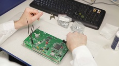 Man repairing a chip soldering iron Stock Footage