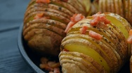Baked potato with bacon and spices Stock Footage