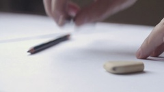 Close up of a male hand drawing with a black pencil Stock Footage