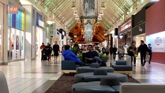 Motion of people shopping inside Coquitlam Center shopping mall Stock Footage