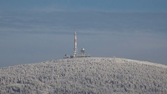 4k Snowy winter Harz mountain Brocken peak zoom out Torfhaus tourism parking Stock Footage