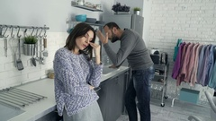 Attractive young couple arguing in the kitchen, 4K Stock Footage