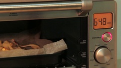Closeup shot of fish pieces cooking in the modern electronic oven. Stock Footage