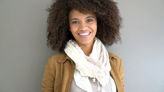 Cheerful mixed-race woman standing on grey background, isolated Stock Footage