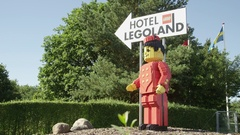 Statue pointing the way to Lego Land in Denmark Stock Footage