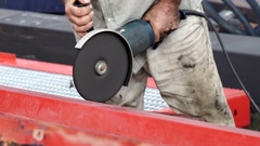 A man uses a circular saw to cut the metal. Detail. Stock Footage