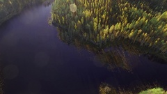 Old fortification barrier by a canal with autumn-colored forest surrounding Stock Footage