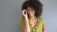 Portrait of cheerful trendy mixed-race girl Stock Footage