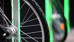 Urban bicycle sharing system wheel detail Stock Footage
