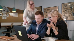 Close up female team leader pointing at screen. Creative business team meeting Stock Footage