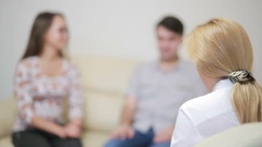 Female psychologist helping worried young couple. family therapy Stock Footage