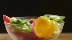 Fresh vegetables falling in an empty glass bowl. Stock Footage