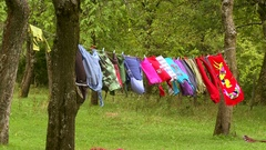 Clothing hanging on the wire for drying clothes in village household Stock Footage