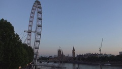 Wide London View Crepuscle with Fun Wheel and Westminster Palace near Thames. Stock Footage