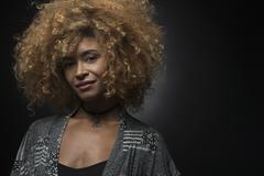 Portrait of cool blond woman on black background Kuvituskuvat