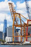 USA, New York State, New York City, Manhattan, Commercial dock against city Stock Photos