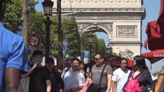 Paris Citizens and Tourists Walking on Boulevard Sidewalk Visiting City Center. Stock Footage