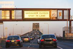 USA, New Jersey, Jersey City, Traffic at entrance to bridge Stock Photos