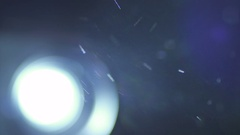 The very bright projector light with dust particle stream. Macro close up view Stock Footage