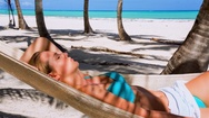 Woman lying in hammock Stock Footage
