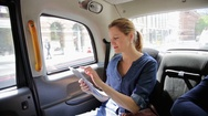 Woman using tablet in car Stock Footage