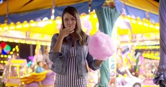 Young woman having fun at a colorful fairground Stock Footage