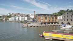 Bristol harbourside canal boat pan sunny Stock Footage