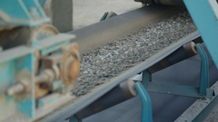 Belt conveyor moves various stone mixtures for further processing Stock Footage