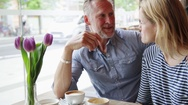 Couple talking in cafe Stock Footage