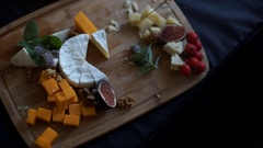 Cheese for tasting on wooden background, top view Stock Footage