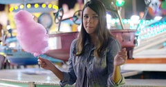 Happy young woman enjoying a night at a fair Stock Footage