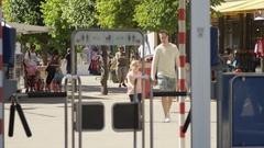 Tourists walking through LegoLand Amusement Park Stock Footage