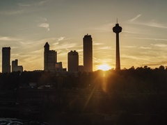 Sunset over buildings of Niagara Falls on the Canadian side of the river. View Stock Footage