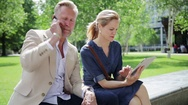 Man with smartphone and woman with tablet Stock Footage