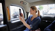 Woman in car taking photos with tablet Stock Footage