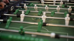 Friends having fun together playing table football. Stock Footage